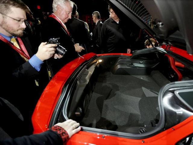 The rear trunk hood is opened to highlight the trunk space of the new Corvette Stingray after its unveiling in Detroit, the night before press days at the North American International Auto Show in Detroit. When 1,000 GM engineers and designers started work on the next-generation Corvette, they began with the usual priority list for a muscle car, but topping the list was something that belies the roar of the Chevrolet's giant V-8: Gas mileage. (AP Photo/Carlos Osorio)
