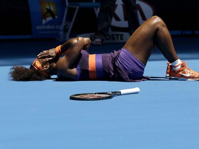 Serena-Williams-lies-on-the-court-after-falling-during-her-first-round-match-against-Romania-s-Edina-Gallovits-Hall-at-the-Australian-Open-tennis-championship-in-Melbourne-AP-Photo