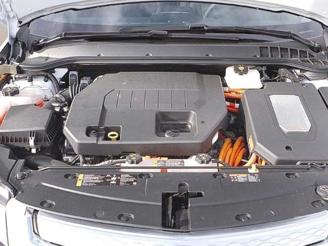Conventional combustion engine plus high-voltage orange wiring.