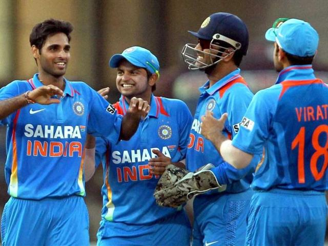 Bhuvaneshwar-Kumar-celebrates-the-wicket-of-England-s-Kevin-Pietersen-with-Suresh-Raina-MS-Dhoni-and-Virat-Kohli-during-the-2nd-ODI-cricket-match-in-Kochi-on-Tuesday-PTI-Photo