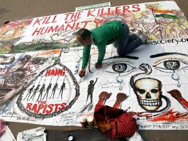 A-protester-make-paintings-on-completion-of-first-month-of-the-Delhi-gangrape-and-murder-of-the-23-year-old-at-Jantar-Mantar-in-New-Delhi-PTI-Photo