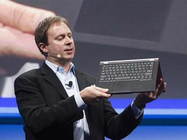 Kirk-Skaugen-Intel-s-vice-president-of-PC-client-group-converts-a-Lenovo-Yoga-Ultrabook-into-a-tablet-at-an-Intel-news-conference-during-the-Consumer-Electronics-Show-CES-in-Las-Vegas-Credit-Reuters-Steve-Marcus