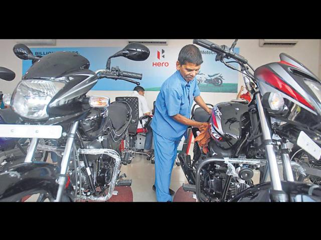SLOWING-DOWN-A-worker-cleans-a-bike-at-a-Hero-MotoCorp-showroom-in-Mumbai-on-Thursday-Photo-Reuters