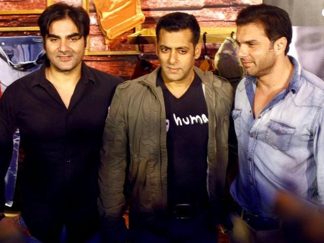 Bollywood-star-Salman-Khan-center-along-with-his-brothers-Arbaaz-Khan-left-and-Sohail-Khan-poses-for-photographs-during-the-launch-of-Being-Human-s-first-flagship-store-in-Mumbai-on-January-17-2013-Being-Human-is-a-charitable-trust-that-helps-spread-education-and-healthcare-for-underprivileged-children-AP-Photo