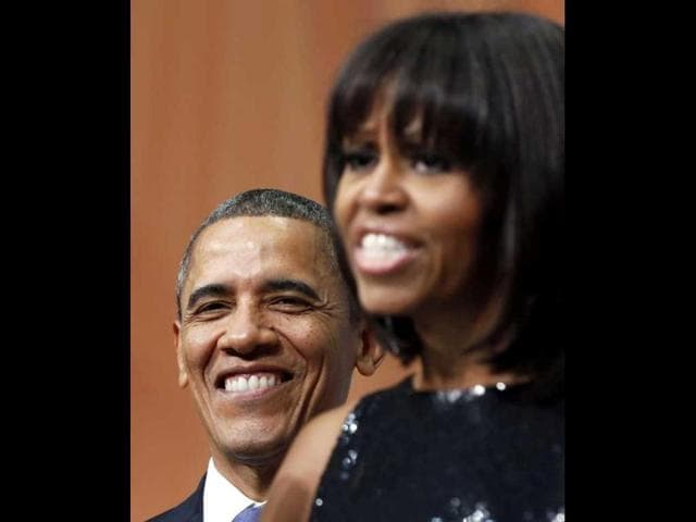 US-President-Barack-Obama-smiles-as-he-listens-to-first-lady-Michelle-Obama-at-an-inaugural-reception-at-the-National-Building-Museum-in-Washington-Rueters