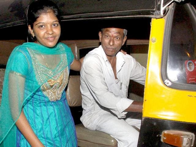 Prema-Jayakumar-who-scored-first-rank-in-the-chartered-account-examinations-poses-for-a-photo-with-her-father-Jayakumar-Perumal-who-is-an-auto-rickshaw-driver-in-Mumbai-PTI-Photo
