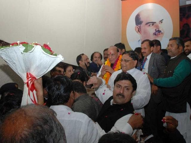 BJP president Rajnath Singh is seen with party workers after addressing a press conference in New Delhi. UNI