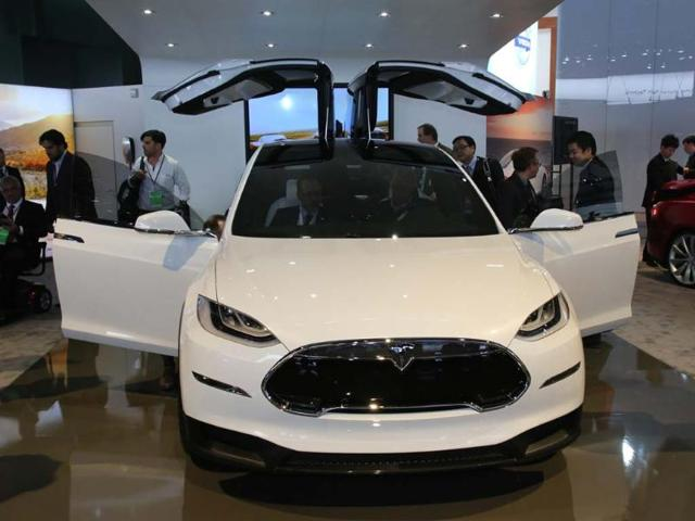 Tesla-Model-X-Described-as-a-crossover-sport-utility-vehicle-it-is-destined-for-production-before-the-end-of-the-year-Available-with-4-wheel-drive-the-Model-X-is-electric-only-and-has-a-range-of-210-miles-340km-between-charges-It-will-also-feature-rear-gull-wing-doors-which-will-look-dramatic-but-could-cause-problems-in-carparks-Photo-AFP