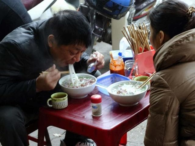In-Hanoi-it-is-a-truth-universally-acknowledged-that-the-best-pho-noodle-soup-is-found-in-the-grimiest-restaurants-where-the-staff-are-rude-the-queues-long-and-the-surroundings-spartan-at-best-Photo-AFP-Hoang-Dinh-Nam