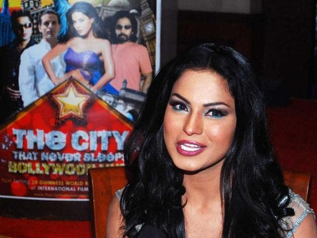 Pakistani actor Veena Malik addresses during the press conference to announce The City That Never Sleeps- Bollywood Hunt contest. (UNI PHOTO)