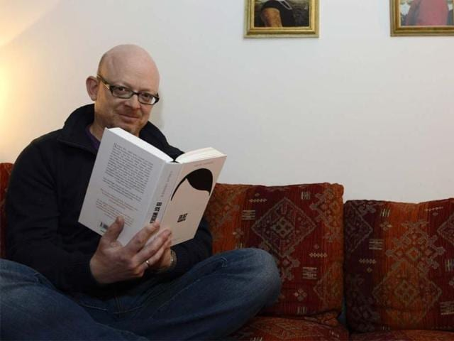 German-book-writer-Timur-Vermes-poses-with-his-new-book-Er-ist-wieder-da-in-his-flat-in-Munich-southern-Germany-Photo-AFP-Christof-Stache