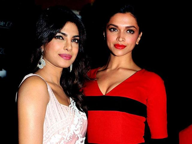 Priyanka-Chopra-L-and-Deepika-Padukone-in-Mumbai-at-a-special-screening-of-Race-2-directed-by-Abbas-Mustan-AFP-PHOTO