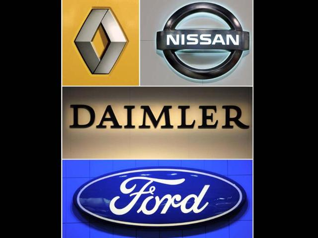 A-combo-made-on-January-28-2013-shows-the-logos-of-carmakers-Renault-L-Nissan-R-Daimler-C-and-Ford-The-Franco-Japanese-automakers-Renault-Nissan-said-on-January-28-2013-that-they-have-signed-a-deal-with-Daimler-and-Ford-jointly-to-develop-a-fuel-cell-which-would-equip-electric-cars-from-2017-The-three-groups-plan-to-hold-equal-shares-in-the-project-and-expect-to-launch-the-first-large-scale-production-of-affordable-fuel-cell-powered-vehicles-in-2017-a-statement-said-Photo-AFP