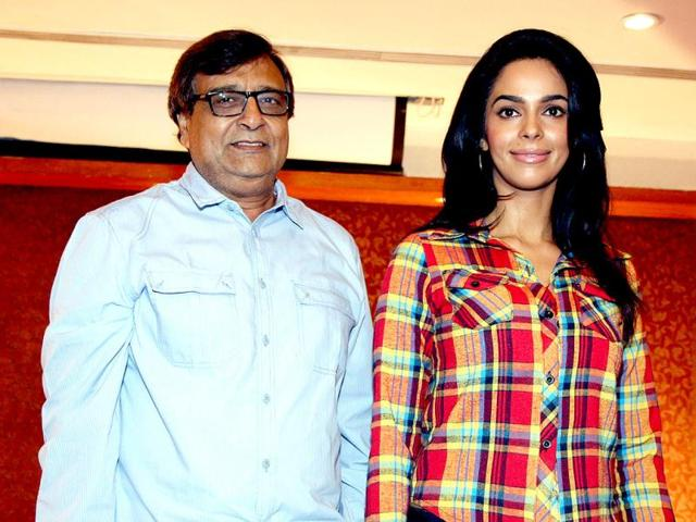 Mallika-Sherawat-R-poses-for-a-photo-during-a-promotion-for-the-upcoming-film-Dirty-Politics-directed-by--KC-Bokadia-L-in-Mumbai-on-January-28-2013-AFP-PHOTO
