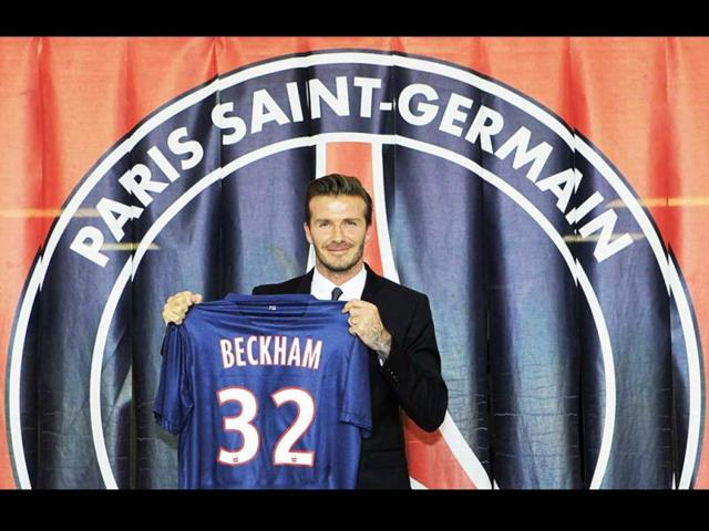 Soccer-player-David-Beckham-presents-his-new-jersey-after-a-news-conference-in-Paris-Former-England-captain-David-Beckham-has-joined-Paris-St-Germain-on-a-five-month-contract--Reuters