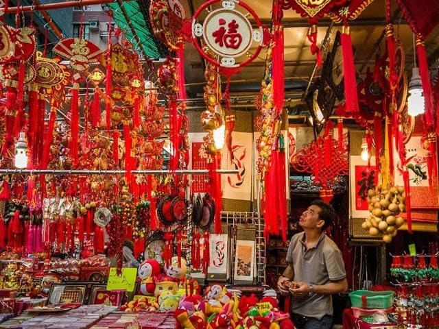 A-vendor-looks-at-his-display-of-Chinese-New-Year-items-for-sale-at-a-street-market-in-Hong-Kong-on-January-31-2013-The-Chinese-New-Year-of-the-snake-falls-on-February-10-2013-Photo-AFP-Philippe-Lopez