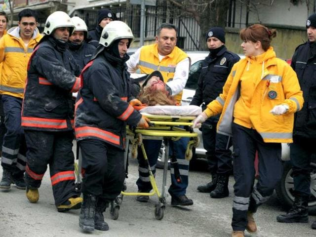 Medics-carry-an-injured-woman-on-a-stretcher-to-an-ambulance-after-a-suspected-suicide-bomber-detonated-an-explosive-device-at-the-entrance-of-the-US-Embassy-in-Ankara-Turkey-AP-Photo