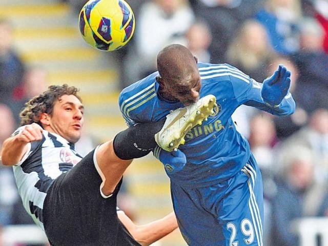 Chelsea-s-Demba-Ba-gets-a-mouthful-from-the-boot-of-former-skipper-Fabricio-Coloccini-of-Newcastle-United-The-Magpies-won-3-2-at-home-on-Saturday-AFP