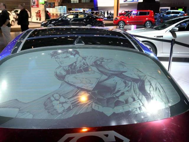 The rear window displays Superman of the Kia DC Comics Superman Edition Optima Hybrid at the Chicago Auto Show in Chicago. (AFP Photo)