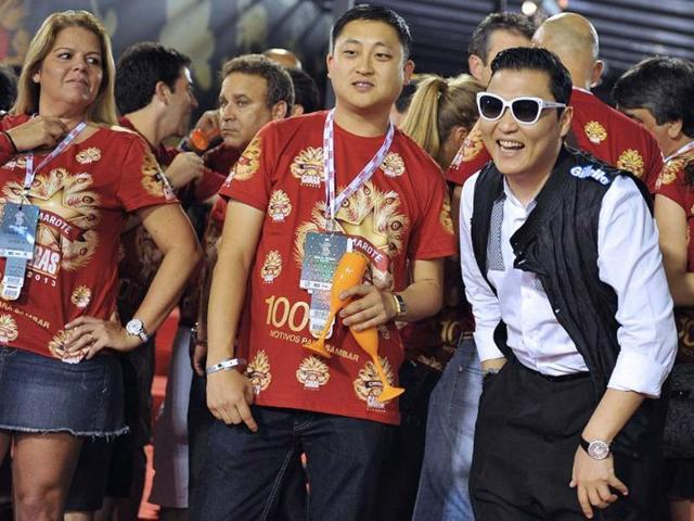 South-Korean-singer-Psy-R-smiles-at-the-Sambadrome-in-Rio-de-Janeiro-Brazil-Photo-AFP-Vanderlei-Almeida