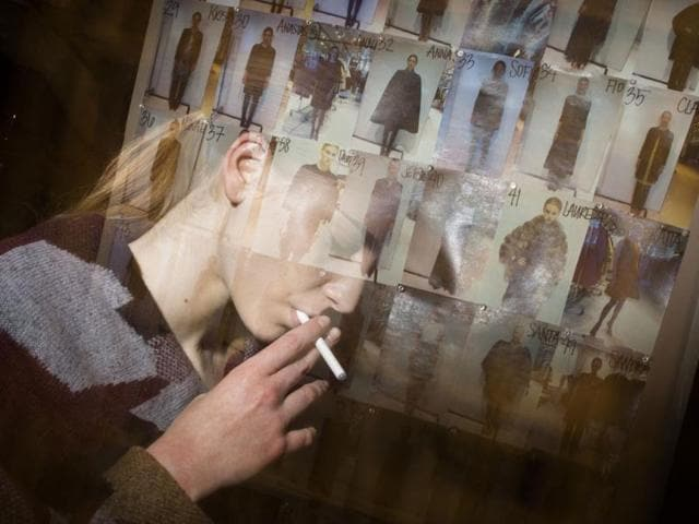 In-this-photo-made-with-multiple-flash-exposures-a-model-pulls-on-an-electronic-cigarette-backstage-before-the-Chado-Ralph-Rucci-Fall-2013-collection-is-shown-during-Fashion-Week-in-New-York-AP-photo