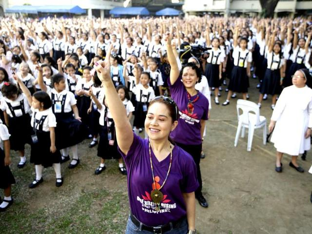 Students-and-Roman-Catholic-nuns-of-St-Scholastica-s-College-an-all-girls-school-dance-to-kickoff-a-global-campaign-dubbed-One-Billion-Rising-on-Valentine-s-Day-in-Manila-Philippines-AP-Photo