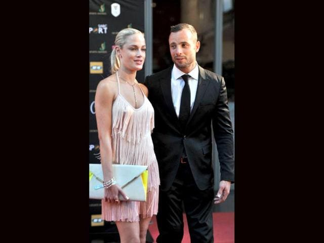 Oscar-Pistorius-and-his-model-girlfriend-Reeva-Steenkamp-at-the-Feather-Awards-Melrose-Arch-Johannesburg-AFP-file-photo
