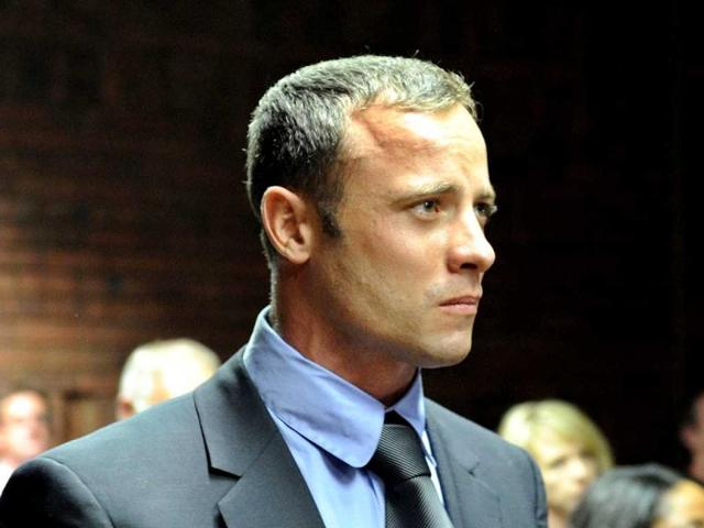 Oscar-Pistorius-awaits-the-start-of-court-proceedings-while-his-brother-Carl-L-looks-on-in-the-Pretoria-Magistrates-court-Reuters
