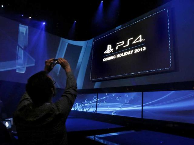 A-man-takes-a-picture-at-the-PlayStation-4-launch-event-in-New-York-Reuters-Brendan-McDermidd