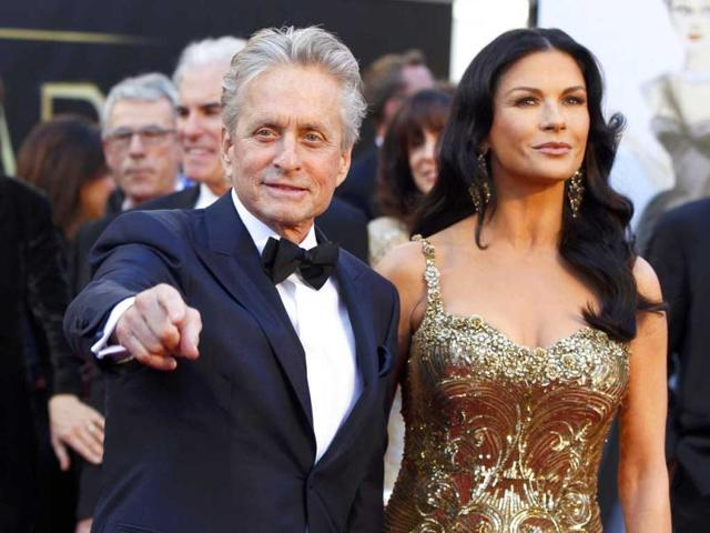 Catherine Zeta Jones and Michael Douglas arrive at the 85th Academy Awards in Hollywood, California February 24, 2013. Reuters Photo