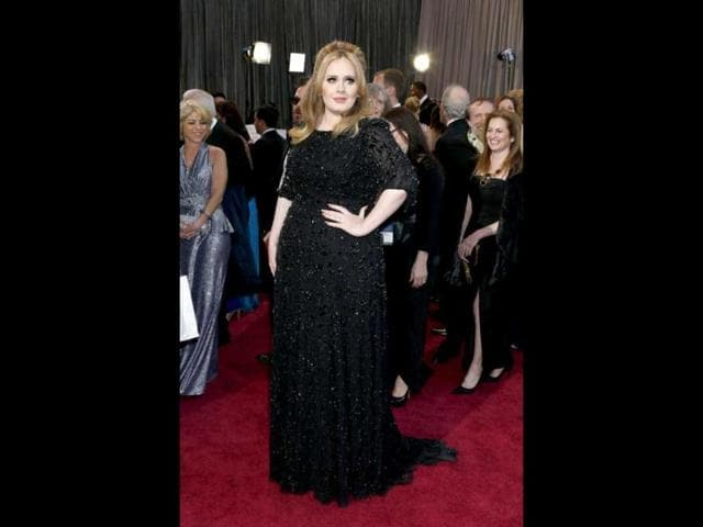 Singer-Adele-arrives-on-the-red-carpet-for-the-85th-Annual-Academy-Awards-on-February-24-2013-in-Hollywood-California-AFP-Photo