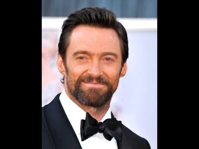 Actor Hugh Jackman arrives at the Oscars at the Dolby Theatre on Sunday Feb. 24, 2013, in Los Angeles. AP Photo