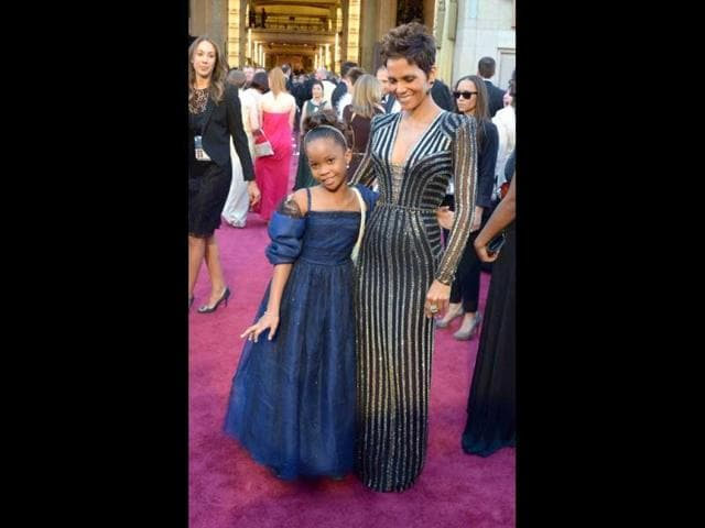 Best Actress nominee Quvenzhané Wallis (L) and actress Halle Berry arrive on the red carpet for the 85th Annual Academy Awards on February 24, 2013 in Hollywood, California. AFP Photo