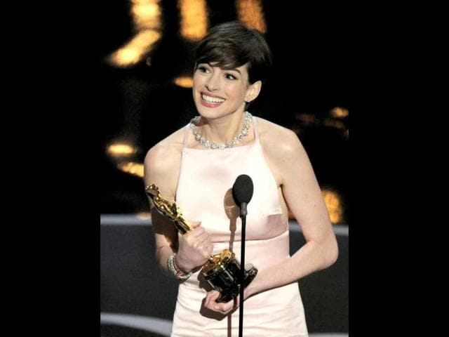 Anne-Hathaway-accepts-the-award-for-best-actress-in-a-supporting-role-for-Les-Miserables-during-the-Oscars-at-the-Dolby-Theatre-in-Los-Angeles-AP