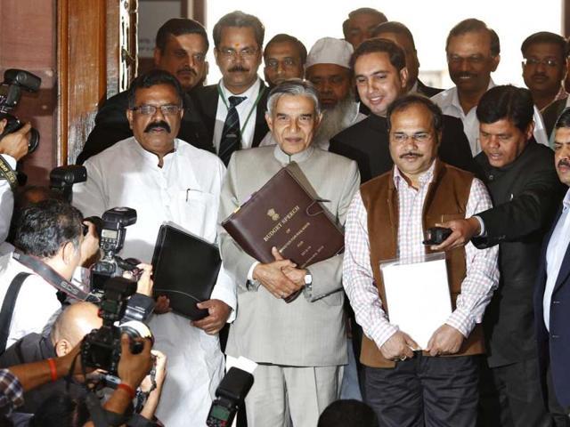 Union-railway-minister-Pawan-Kumar-Bansal-C-carries-his-budget-speech-as-he-walks-towards-Parliament-to-present-the-union-railway-budget-2013-14-in-New-Delhi-AFP