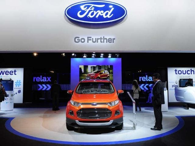 A-visitor-looks-at-a-Ford-B-Max-car-at-the-2013-Mobile-World-Congress-in-Barcelona-on-February-27-2013-Photo-AFP
