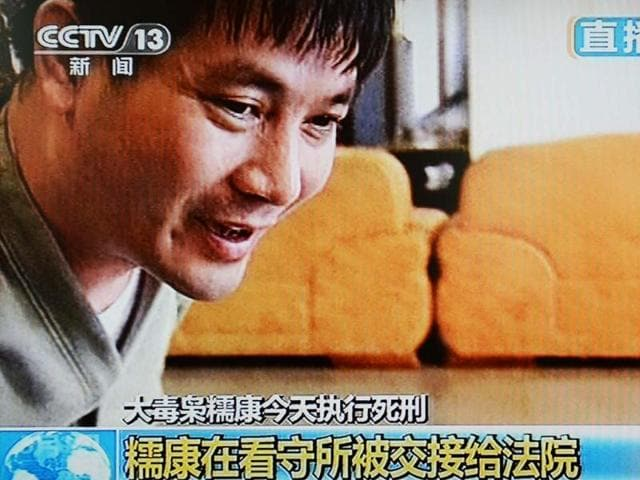 This-frame-grab-taken-from-Chinese-television-CCTV-shows-convicted-murderer-and-gang-leader-Naw-Kham-of-Burma-being-led-from-his-prison-cell-as-he-is-transferred-for-execution-in-Yunnan-Province-AFP-Photo