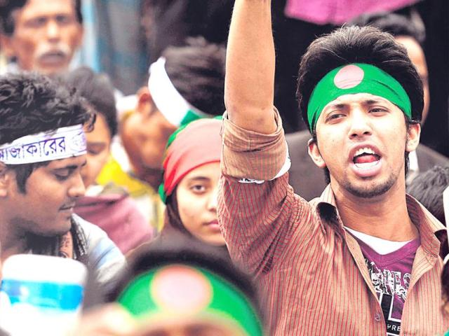 Bangladeshis-protest-at-Shahbagh-square-in-Dhaka-demanding-the-death-penalty-for-Jamaat-Leader-Abdul-Qadar-Mollah-and-other-leaders-who-were-involved-in-war-crimes-during-Bangladesh-s-War-of-Liberation-in-1971-The-war-tribunal-set-by-Sheikh-Hasina-government-in-2010-sentenced-Mollah-for-10-years-Getty-Images