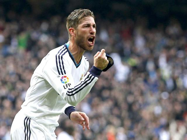 Real-Madrid-s-Sergio-Ramos-celebrates-after-scoring-a-goal-during-their-Spanish-first-division-classico-match-against-Barcelona-at-the-Santiago-Bernabeu-stadium-in-Madrid-Reuters