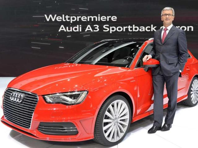 German carmaker Audi CEO Rupert Stadler poses with the new Audi A3 Sportback model displayed in World premiere at the Geneva International Motor Show. AFP photo