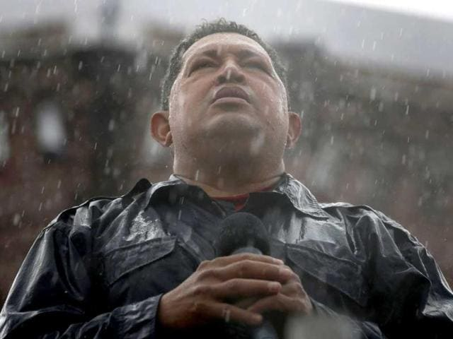 Venezuela-s-President-and-presidential-candidate-Hugo-Chavez-speaks-in-the-rain-during-his-closing-campaign-rally-in-Caracas-in-this-October-4-2012-file-photo-Chavez-died-on-March-5-2013-after-a-two-year-battle-with-cancer-Reuters