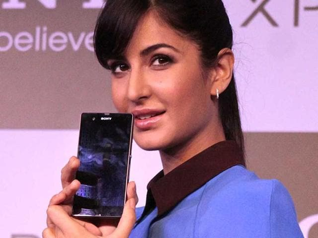Katrina-Kaif-with-Dennis-van-Schie-Corporate-Vice-President-of-Sony-Mobile-Communications-and-Kenichiro-Hibi-R-Managing-Director-Sony-India-during-the-launch-of-Sony-Xperia-Z-Photo-PTI-Subhav-Shukla