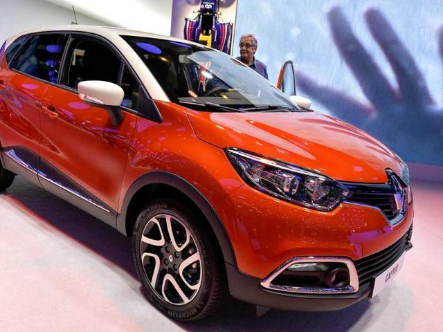 The new French Renault Captur model car is displayed as a world premiere at the Geneva International Motor Show. (AFP Photo)
