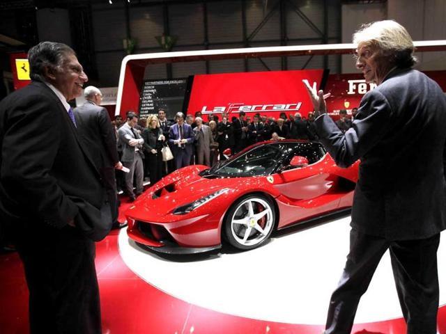 Ferrari CEO Luca Cordero di Montezemolo (R) talks to chairman Emeritus of Tata Group, Ratan Tata after the presentation of the new LaFerrari hybrid car on the Ferrari stand during the first media day of the 83rd Geneva Car Show at the Palexpo Arena in Geneva. (Reuters)