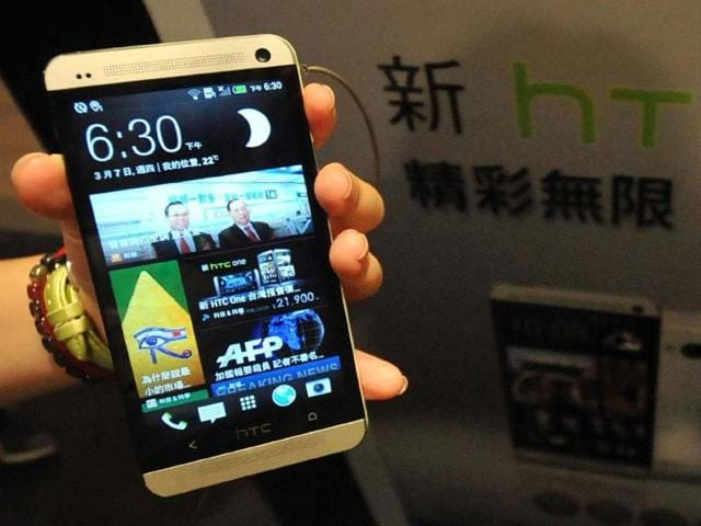 A-staff-member-displays-Taiwanese-smartphone-maker-HTC-s-new-HTC-One-during-a-press-conference-in-Taipei-Photo-AFP-Mandy-Cheng