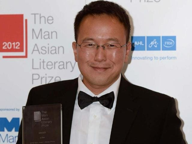 Malaysian-author-Tan-Twan-Eng-poses-for-a-photo-after-winning-the-Man-Asian-Literary-Prize-for-his-novel-The-Garden-of-Evening-Mists-in-Hong-Kong-Photo-AFP-Philippe-Lopez