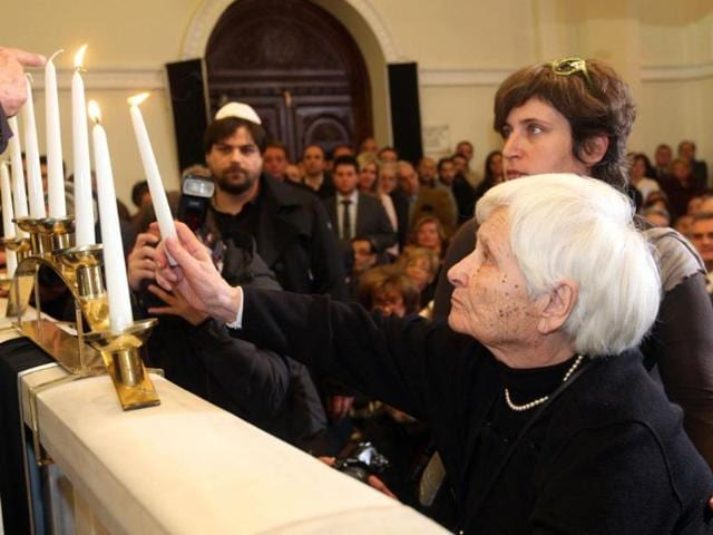 A-Holocaust-survivor-lights-a-candle-at-the-Monastiriotes-Synagogue-in-Thessaloniki-Greece-s-second-largest-city-is-commemorating-the-70th-anniversary-of-the-first-deportation-of-its-Jews-to-Auschwitz-concentration-camp-on-March-15-1943-AFP-photo