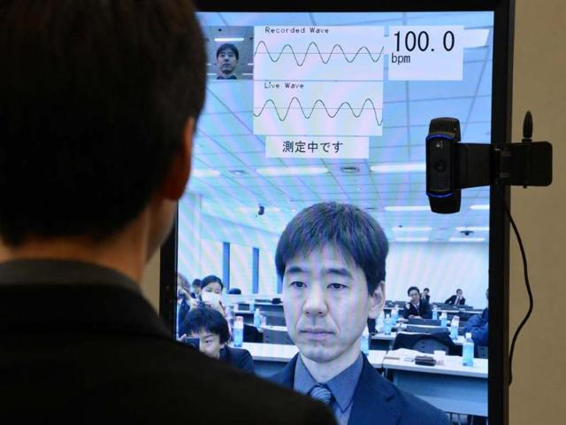 A-Fujitsu-engineer-demonstrates-new-technology-a-the-real-time-pulse-monitor-system-with-facial-imaging-technology-that-ustilises-a-web-camera-in-PCs-or-smartphones-at-the-company-s-headquarters-in-Tokyo-Photo-AFP-Yoshikazu-Tsuno