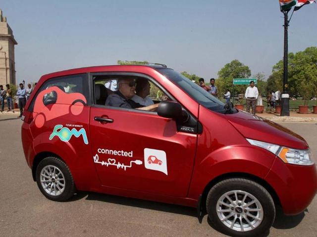Launch Mahindra Reva 'e2o' New Delhi: New and Renewable Energy Minister Farooq Abdullah and Heavy Industries Minister Praful Patel ride Mahindra Reva 'e2o' car after its launch at India Gate in New Delhi on Monday. Photo:PTI/Manvender Vashist
