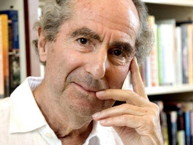 A-file-photo-of-author-Philip-Roth-posing-for-a-photo-in-the-offices-of-his-publisher-Houghton-Mifflin-in-New-York-AP